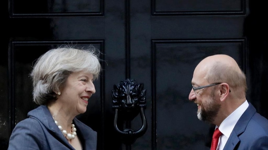 British Prime Minister Theresa May, left, greets the President of the European Parliament Martin Schulz before their talks at 10 Downing Street in London, Thursday, Sept. 22, 2016. (AP Photo/Matt Dunham)