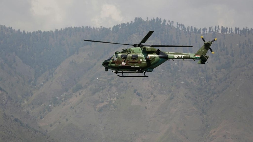 "File – In this Sept. 18, 2016 file photo, an Indian army helicopter flies over the army base which was attacked by suspected rebels in the town of Uri, west of Srinagar, Indian controlled Kashmir. Even with his own officials saying the attack was launched by Pakistan-based militants, Modi is relying on diplomacy more than saber-rattling. In large part, this is because Modi and Indian forces already must defuse the massive and relentless anti-India protests that have swept its portion of Kashmir, triggered by the killing of a young rebel leader more than two months ago. In a speech at the U.N. General Assembly on Sept. 21, Sharif strongly criticized India's suppression of protests in Kashmir, calling for an independent inquiry into killings there and a U.N. fact-finding mission to investigate what he called India's ""brutalities."" (AP Photo/Mukhtar Khan, File)"