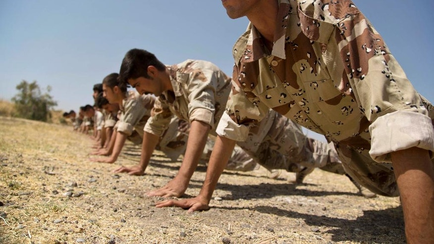 """In this Wednesday, Sept. 21, 2016 photo, new recruits of the Democratic Party of Iranian Kurdistan train at their base in Koya, northern Iraq. The main Kurdish opposition group in Iran will keep up its guerrilla campaign against security forces """"to protect and defend"""" Kurds living there. That's according to the deputy leader of the Democratic Party of Iranian Kurdistan. He calls the fight necessary after the Islamic Republic's nuclear deal with world powers.(AP Photo/Maya Alleruzzo)"""