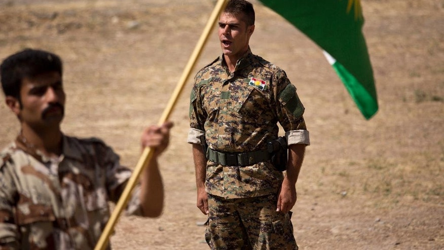 "In this Wednesday, Sept. 21, 2016 photo, a commander instructs new recruits of the Democratic Party of Iranian Kurdistan during training at their base in Koya, northern Iraq. The main Kurdish opposition group in Iran will keep up its guerrilla campaign against security forces ""to protect and defend"" Kurds living there. That's according to the deputy leader of the Democratic Party of Iranian Kurdistan. He calls the fight necessary after the Islamic Republic's nuclear deal with world powers.(AP Photo/Maya Alleruzzo)"