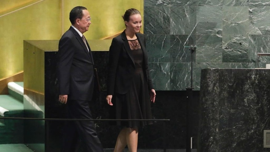North Korea's Foreign Minister Ri Yong Ho is escorted to the podium to address the 71st session of the United Nations General Assembly, at U.N. headquarters, Friday, Sept. 23, 2016. (AP Photo/Richard Drew)