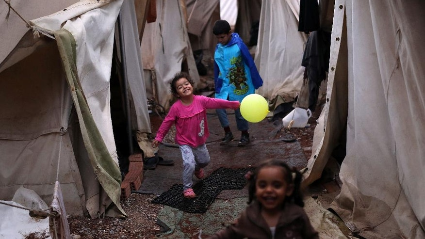 "Children play among tents at Ritsona refugee camp north of Athens, which hosts about 600 refugees and migrants on Thursday, Sept. 22, 2016. Most of the roughly 60,000 refugees and other migrants stranded in Greece are living in ""appalling conditions"" and face ""immense and avoidable suffering,"" rights group Amnesty International said in a report Thursday, slamming Europe's response to the refugee crisis. . (AP Photo/Petros Giannakouris)"