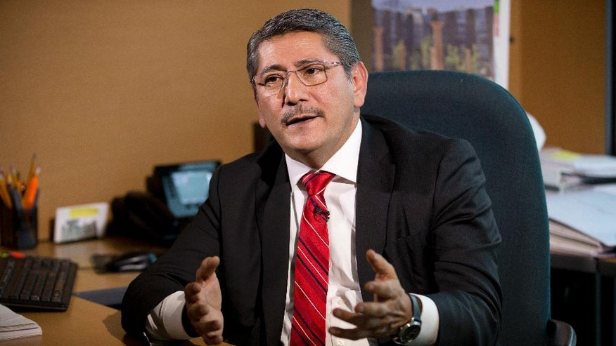 Alfredo Higuera, of the Mexican Attorney General's Office special prosecutor for the case of the 43 missing students, speaks during an interview in Mexico City, Thursday, Sept. 22, 2016. Higuera says he wants to perform a new forensic examination of a garbage dump where it was maintained that the 43 missing students were incinerated by a drug gang two years ago. Higuera said Thursday that investigators are not married to any single theory about the fate of the students from the Rural Normal School at Ayotzinapa. (AP Photo/Eduardo Verdugo)