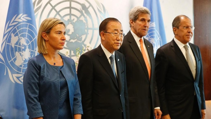 European Union High Representative Federica Mogherini, left, United Nations General Secretary-General Ban Ki-moon, second from left, U.S. Secretary of State John Kerry, second from right, and Russian Foreign Minister Sergey Lavrov pose for photographers before a meeting of the Middle East quartet at U.N. headquarters, Friday, Sept. 23, 2016. (AP Photo/Mary Altaffer)