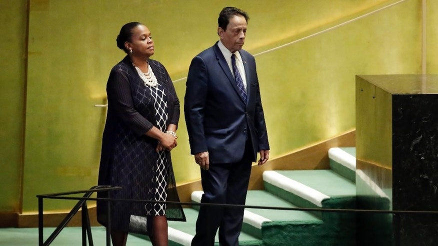 Mauritius Prime Minister Anerood Jugnauth is escorted to the podium to address the 71st session of the United Nations General Assembly, at U.N. headquarters, Friday, Sept. 23, 2016. (AP Photo/Richard Drew)