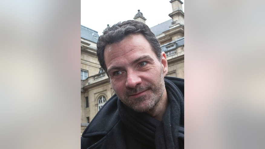 FILE - In this file photo dated Monday, March 21, 2016, Jerome Kerviel smiles as he leaves Paris cour house in Paris.  Kerviel will learn Friday Sept. 23, 2016, whether he'll have to pay a staggering 4.9 billion euros ($5.5 billion) to the Societe Generale bank that employed him when he made huge losses through reckless operations.AP Photo/Michel Euler, FILE)