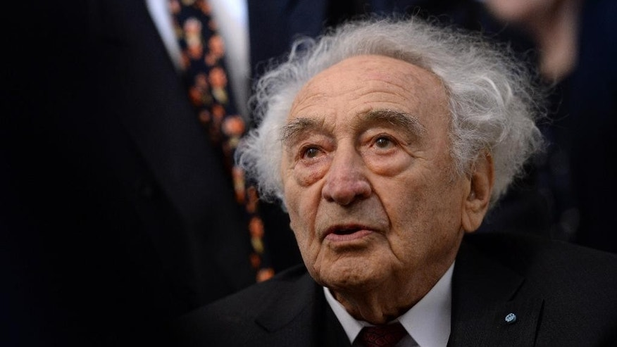 FILE - In this Jan. 27, 2015 file photo Holocaust survivor Max Mannheimer arrives for a ceremony marking the 70th anniversary of the Auschwitz concentration camp in Munich, southern Germany. Mannheimer died Friday, Sept. 23, 2016. He was 96. (Andreas Gebert/dpa via AP, file)