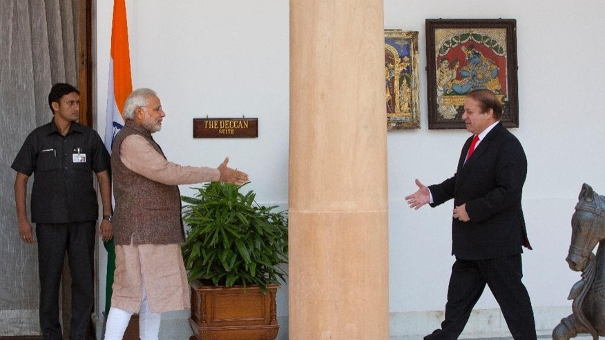 FILE – In this May 27, 2014 file photo, Indian Prime Minister Narendra Modi, left, walks to shake hand with his Pakistani counterpart Nawaz Sharif before the start of their meeting in New Delhi, India. Modi said in a speech Saturday, Sept. 24, 2016, that he'll work to isolate Pakistan internationally, accusing India's archrival of trying to destabilize Asia by exporting terrorism. (AP Photo /Manish Swarup, File)