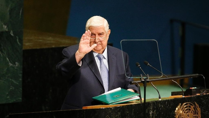 Syria's Foreign Minister Walid al-Moallem waves after addressing the 71st session of the United Nations General Assembly at U.N. headquarters, Saturday, Sept. 24, 2016. (AP Photo/Jason DeCrow)