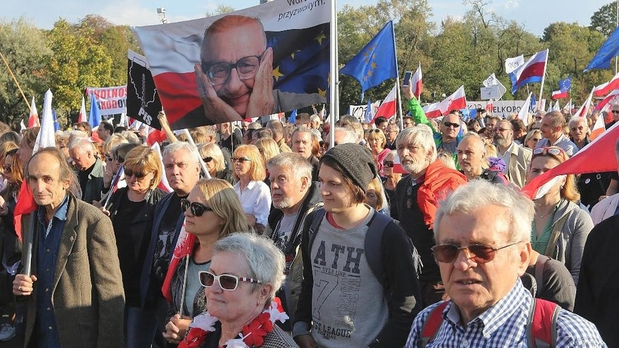 Thousands of protesters march in Warsaw, Poland, Saturday, Sept. 24, 2016, in the latest protest against the policies of the conservative government that critics say are dividing the nation. Protesters came from many corners of Poland for the protest organized by the Committee for the Defense of Democracy, or KOD. The group has organized regular protests against the 10-month-old Law and Justice government. (AP Photo/Czarek Sokolowski)