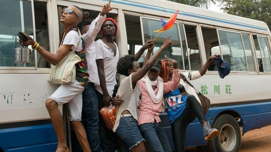 "Members of Uganda's gay and transgender community yell ""we want peace"" after police forced them to leave the gay pride festival in Entebbe, Uganda, Saturday, Sept. 24, 2016. Ugandan police on Saturday prevented organizers from holding a gay pride parade on the orders of a government minister who said such an event is illegal. (AP Photo/Katie G. Nelson)"