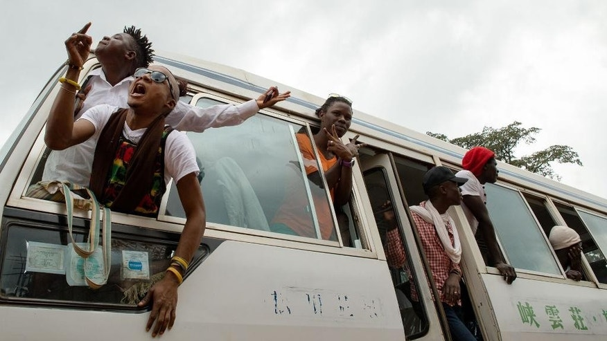 "Members of Uganda's gay and transgender community yell ""we want peace"" after police forced them to leave the gay pride festival in Entebbe, Uganda, Saturday, Sept.24, 2016. Ugandan police have prevented organizers from holding a gay pride parade on the orders of a government minister who says such an event is illegal. (AP Photo/Katie G. Nelson)"