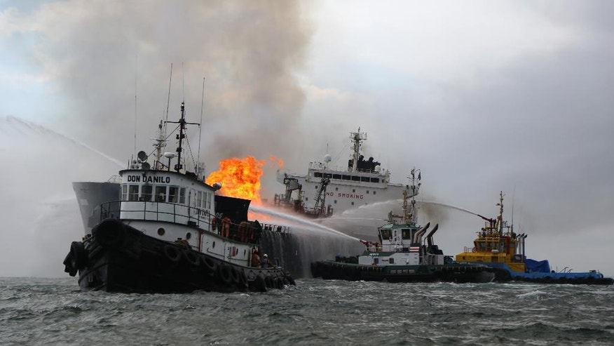 Firefighting boats work to extinguish a fire aboard the tanker Burgos about seven nautical miles off the coast of the port city of Boca del Rio, Mexico, Saturday, Sept. 24, 2016. The tanker was carrying about 168,000 barrels of gasoline and diesel fuel. Mexico's Navy rescued 31 crew members and no injuries were reported. There were no immediate reports of fuel spills and the cause of the fire was unknown. (AP Photo/Ilse Huesca)