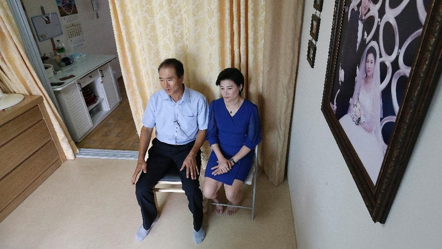 In this Sept. 4, 2016 photo, North Korean defector Kim Jungah, right, speaks during an interview with her husband Kim JongPhil at their house in Gunpo, South Korea. Kim Jungah, a North Korean living in the South who was separated from her child in China, will lead three other defectors on a trip to the United States in October to seek help from U.S. and United Nations officials to get their children back. North Korean women trafficked into China and sold as wives to farmers are often separated from their children when they flee to the South. (AP Photo/Ahn Young-joon)