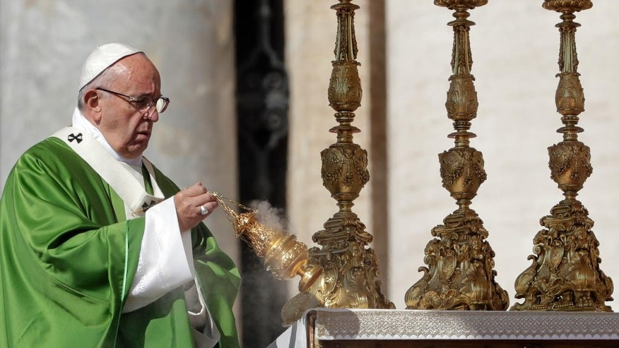 Pope Francis asperses incense as he celebrates a Jubilee Mass for catechists, at the Vatican, Sunday, Sept. 25, 2016. (AP Photo/Andrew Medichini)