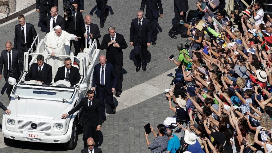 Pope Francis waves to faithful as he leaves after celebrating a Jubilee Mass for catechists, at the Vatican, Sunday, Sept. 25, 2016. (AP Photo/Andrew Medichini)