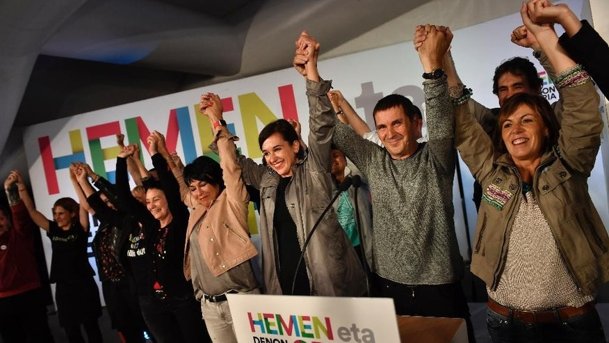 Arnaldo Otegi, second right, a prominent Basque separatist politician of the Basque party EH Bildu, Jasone Agire, third left, and Miren Larrion, right, during the regional elections at the Basque region in San Sebastian, Spain, on Sunday, Sept. 25, 2016. Residents of Spain's Basque and Galicia regions voted in regional parliamentary elections on Sunday, but with few hopes of ending the country's 9-month political stalemate and avoiding a third round of national elections in one year. (AP Photo/Alvaro Barrientos)