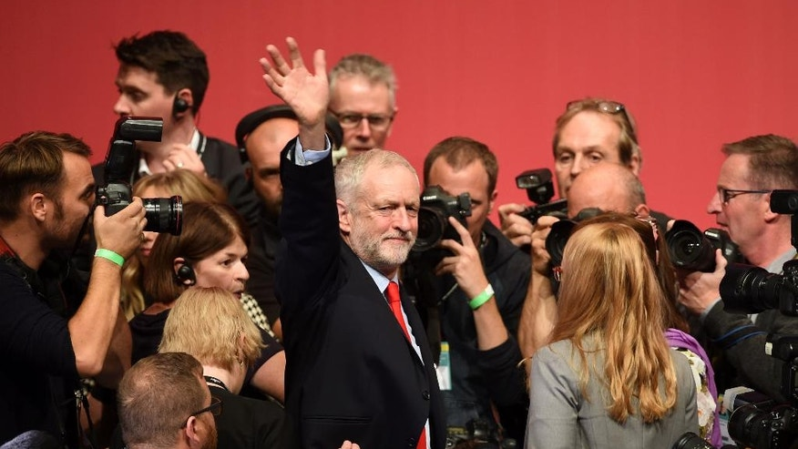 Jeremy Corbyn celebrates his victory following the announcement of the winner in the Labour leadership contest between him and Owen Smith at the ACC Liverpool. England Saturday Sept, 24, 2016. (Danny Lawson/PA via AP)