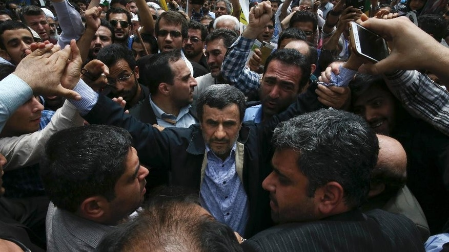 In this picture taken on Friday, July 1, 2016, former Iranian President Mahmoud Ahmadinejad, center, is greeted by well wishers while attending an annual pro-Palestinian rally marking Al-Quds (Jerusalem) Day at the Enqelab-e-Eslami (Islamic Revolution) St. in Tehran, Iran. Close allies of former President Mahmoud Ahmadinejad say Iran's supreme leader has recommended he not run in next May's presidential election because he is a polarizing figure among hard-liners. (AP Photo/Vahid Salemi)
