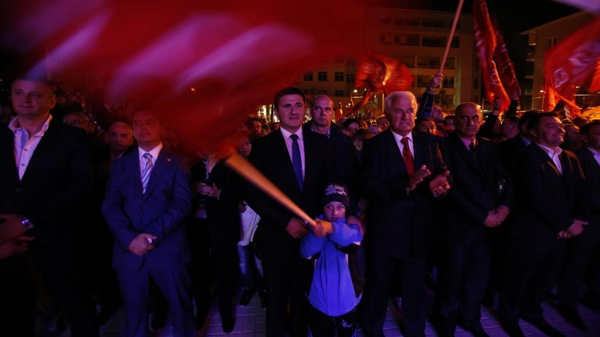 Bosnian people wave flags during the speech of Milorad Dodik, President of the Bosnian Serb region of Republic of Srpska, during celebrations after the result of the referendum in the Bosnian town of Pale, Bosnia, on Sunday Sept. 25, 2016. Sunday's vote asks residents of Republika Srpska whether to maintain a national holiday on Jan. 9, despite a ruling of Bosnia's constitutional court that the date discriminates against non-Serbs. (AP Photo/Amel Emric)
