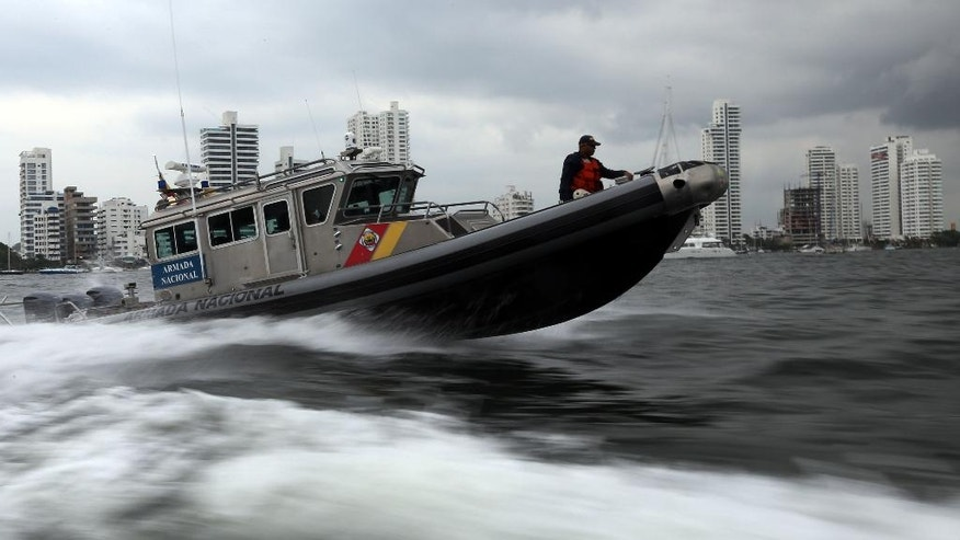 A navy boat patrols in the waters of Cartagena, Colombia, Saturday, Sept. 24, 2016, near the convention center where Colombia's government and the Revolutionary Armed Forces of Colombia, FARC, will sign a peace agreement on Monday, to end over 50 years of conflict . (AP Photo/Fernando Vergara)