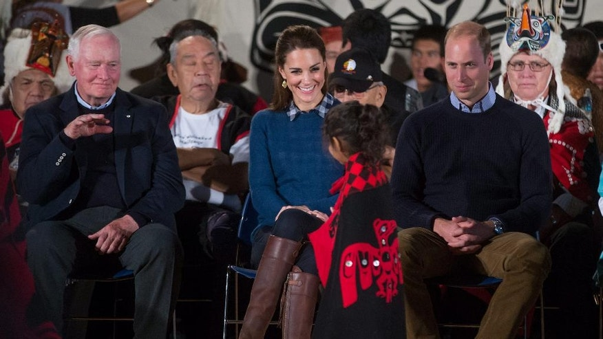 A young First Nations girl walks past Britain's Prince William, the Duke of Cambridge, and Kate, the Duchess of Cambridge, and Governor General David Johnson, left, during a welcoming ceremony at the Heiltsuk First Nation in the remote community of Bella Bella, Canada, Monday, Sept. 26, 2016. (Darryl Dyck/The Canadian Press via AP)
