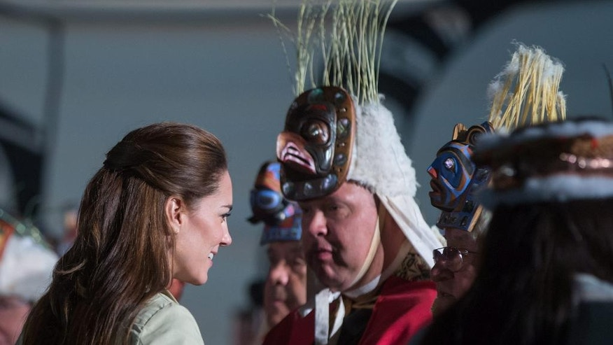 Kate, the Duchess of Cambridge, is greeted by First Nation chiefs during a welcoming ceremony at the Heiltsuk First Nation in the remote community of Bella Bella, Canada, Monday, Sept. 26, 2016. (Darryl Dyck/The Canadian Press via AP)