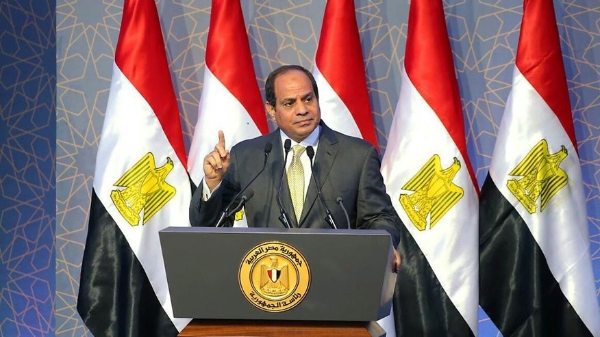 In this picture provided by the office of the Egyptian Presidency, Egyptian President Abdel-Fattah el-Sissi, gives a speech in Egypt, Monday, Sept. 26, 2016. Egypt's president has indignantly rejected criticism that the country's military is being distracted from its core duties by further involving itself in the economy.  (Mohammed Samaha/Egyptian Presidency via AP)