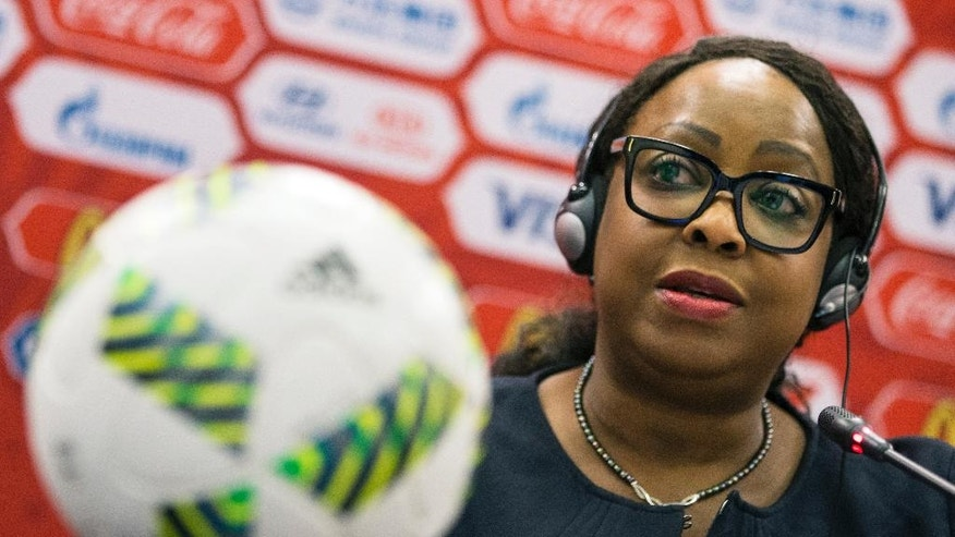 """FILE - This is a Tuesday, July 5, 2016   file photo of FIFA Secretary General Fatma Samoura as she speaks during a news conference in Moscow, Russia. Samoura insisted Monday Sept. 26, 2016  that the fight against racism is being taken """"very seriously"""" despite the governing body's task force overseeing discrimination being abolished. (AP Photo/Pavel Golovkin, File)"""