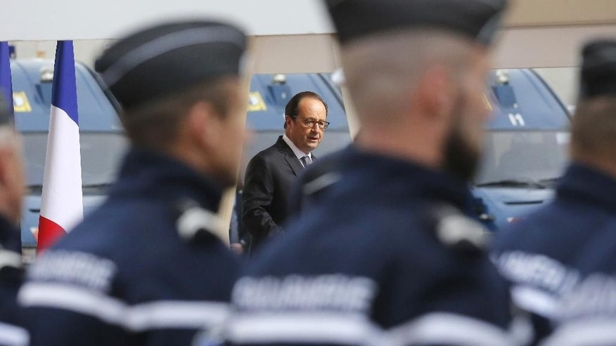 French President Francois Hollande delivers a speech after meeting with officers of the French Gendarmerie during his visit in Calais, northern France, Monday Sept. 26 2016. Hollande says the migrant camp in Calais must be fully dismantled by the end of the year. (Thibault Vandermersch, Pool photo via AP)
