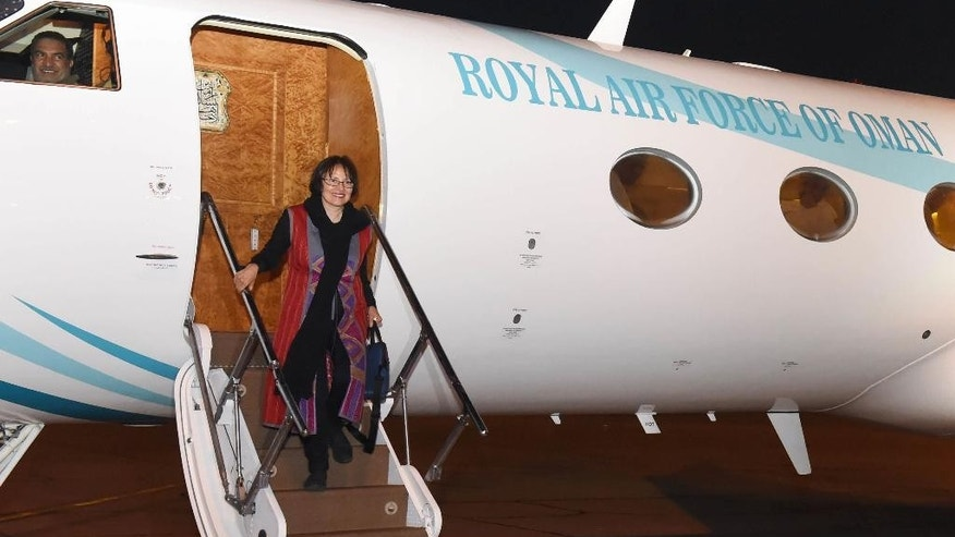 "This photo made available by Oman News Agency, shows retired Iranian-Canadian professor Homa Hoodfar arriving in Muscat airport, Oman, after being released by Iranian authorities, Monday, Sept. 26, 2016. The Canadian-Iranian retired professor was released from prison on ""humanitarian grounds"" and flown out of Iran on Monday, Iran's state-run news agency said, ending her months of detention alongside other dual nationals swept up by hard-liners in the security services.(Oman News Agency via AP)"