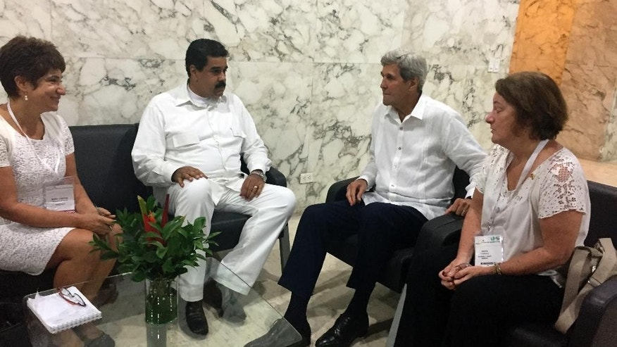 U.S. Secretary of State John Kerry meets with Venezuela president Nicolas Maduro in Cartagena, Colombia Monday, Sept. 26, 2016. (AP Photo/Vivian Salama)
