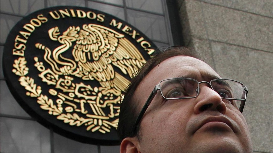 FILE - In this Aug. 5, 2016, file photo, Veracruz Gov. Javier Duarte stands outside the Attorney General's headquarters in Mexico City. The Institutional Revolutionary Party's national justice committee said in a statement Monday, Sept. 26, that it removed the party rights of Veracruz Gov. Duarte and six other party members. Duarte is under federal investigation for corruption.  (AP Photo/Marco Ugarte,File)