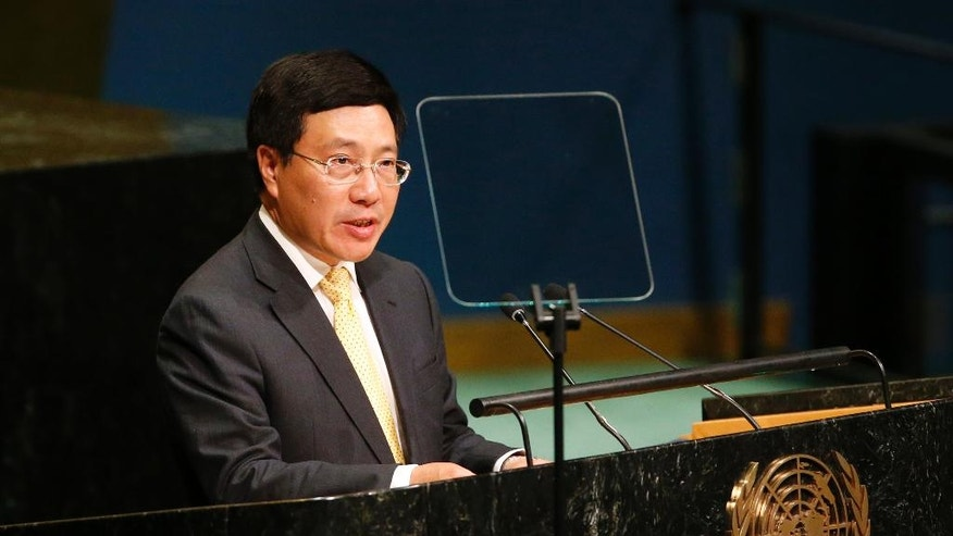 FILE - In this Saturday, Sept. 24, 2016, file photo, Vietnam's Deputy Prime Minister Pham Binh Minh addresses the 71st session of the United Nations General Assembly at U.N. headquarters, New York. Pham called on all parties involved in South China Sea territorial disputes to exercise self-restraint and solve disagreements by peaceful means. (AP Photo/Jason DeCrow, File)