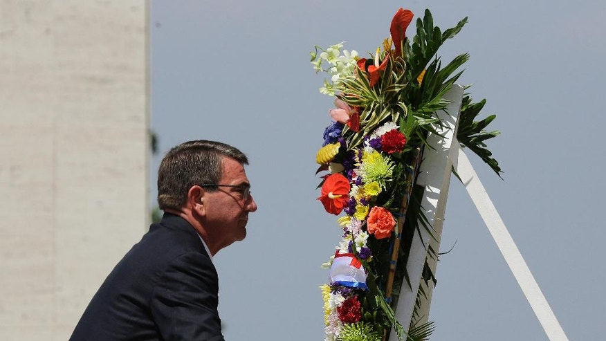 FILE - In this Thursday, April 14, 2016, file photo, U.S. Defense Secretary Ash Carter lays a wreath during ceremonies at the Manila American Cemetery and Memorial in suburban Taguig, south of Manila, Philippines. Philippine military officials on Thursday announced the first large-scale combat exercises between U.S. and Filipino forces under President Rodrigo Duterte, who has been critical of American security policies. (AP Photo/Aaron Favila, File)