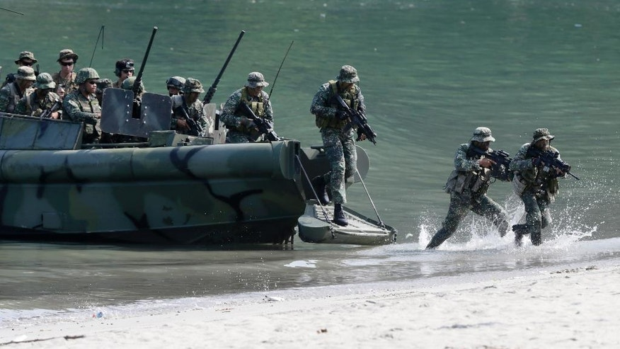 FILE - In this Thursday, Oct. 8, 2015, file photo, U.S. Marines from the 3rd Marine Expeditionary Brigade and the 31st Marine Expeditionary Unit and their Philippine counterpart take part in a boat raid exercise during their joint military exercise at the Philippine marines training center in Ternate township, Cavite province, south of Manila, Philippines. Philippine military officials on Thursday announced the first large-scale combat exercises between U.S. and Filipino forces under President Rodrigo Duterte, who has been critical of American security policies. (AP Photo/Bullit Marquez, File )
