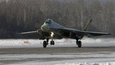 In this photo released by the Sukhoi Company Press Service and taken Thursday, Jan. 28, 2010, a Russian-made Sukhoi T-50 prototype fifth-generation fighter jet is seen at a test airfield near the Siberian city of Komsomolsk-on-Amur, Russia. Russia's new fifth-generation stealth fighter made a successful maiden test flight on Friday, the manufacturer said. (AP Photo/Sukhoi Company Press Service)