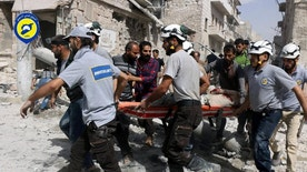 FILE - In this Wednesday, Sept. 21, 2016, file photo, provided by the Syrian Civil Defense White Helmets, rescue workers work the site of airstrikes in the al-Sakhour neighborhood of the rebel-held part of eastern Aleppo, Syria. Syrian Foreign Minister Walid al-Moallem said in a TV interview broadcast Monday, Sept. 26, 2016, that an internationally-brokered cease-fire for Syria is still viable, as rescue workers in Aleppo cleaned up from what they said were the worst airstrikes on rebel-held areas of the northern city in five years. Syria's military declared the cease-fire ended one week ago. (Syrian Civil Defense White Helmets via AP, File)