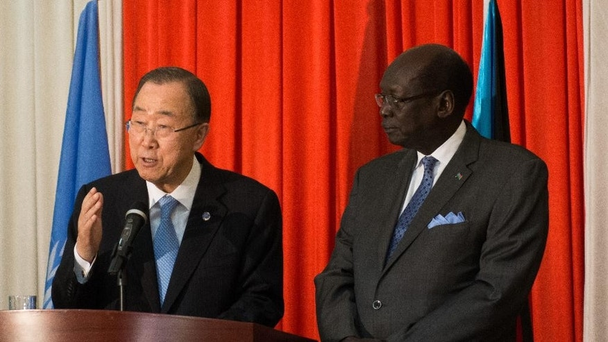 FILE--in this file photo of Thursday Feb. 25, 2016, UN Secretary General Ban Ki Moon, left, speaking to the media in Juba, South Sudan, flanked by the Minister of Foreign Affairs, Barnaba Marial Benjamin.  A confidential report dated Sept. 8, 2016, from U.N. Secretary-General Ban Ki-moon to the U.N. Security Council, obtained by The Associated Press, is a stark list of the ways South Sudan's government has obstructed the U.N. peacekeeping mission in a country devastated by civil war(AP Photo-file)