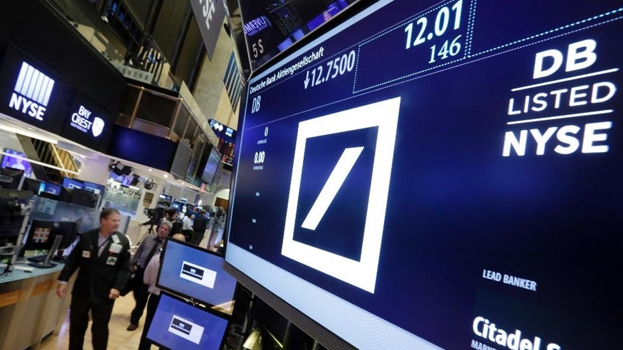 Deutsche Bank shares stabilize as unit sale raises cash