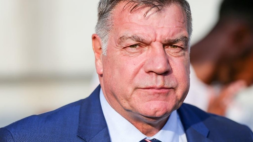 FILE - In this Sunday Sept. 4, 2016 file photo England's coach Sam Allardyce watches from the sidelines during their World Cup Group F qualifying soccer match against Slovakia in Trnava, Slovakia. England manager Sam Allardyce's comments during a newspaper sting will be examined by his employers at the Football Association, after he was filmed by Britain's Daily Telegraph newspaper appearing to advise undercover reporters posing as businessmen on how to sidestep an outlawed player transfer practice.  (AP Photo/Bundas Engler, File)
