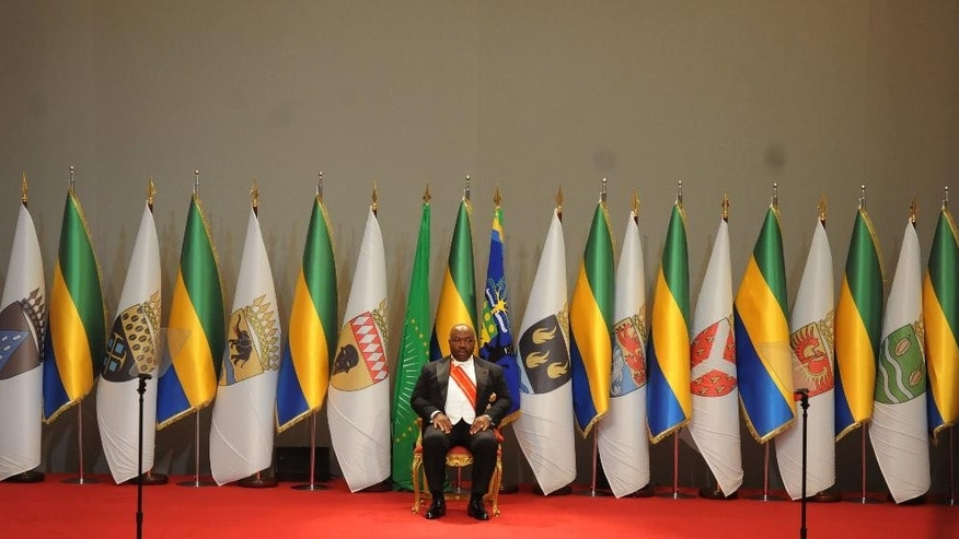Gabon's President Ali Bongo Ondimba, during his swearing in ceremony for a second term in Libreville, Gabon, Tuesday, Sept. 27, 2016. Gabon's President Ali Bongo Ondimba has been sworn in for a second seven-year term, extending a family dynasty in place for decades after a disputed vote saw his re-election by a slim margin.(AP Photo/Jeremi Mba)