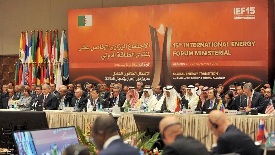 Energy ministers from OPEC and other oil-producing countries attend the opening session of the15th International Energy Forum Ministerial meeting in Algiers, Algeria, Tuesday, Sept. 27, 2016. At meetings in Algeria this week, energy ministers from OPEC and other oil-producing countries are discussing whether to freeze production levels to boost global oil prices. (AP Photo/ Sidali Djarboub)