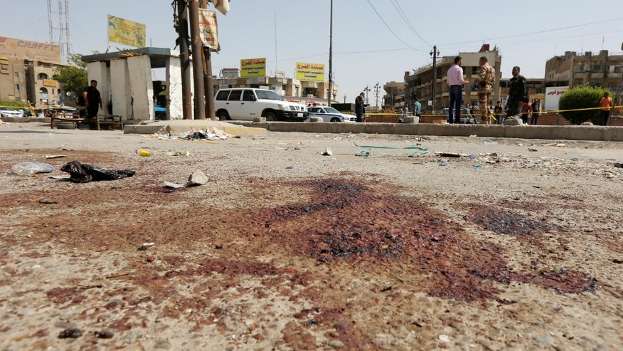 Blood stains seen at the site of a suicide bomb blast in Baghdad al-Jadida.