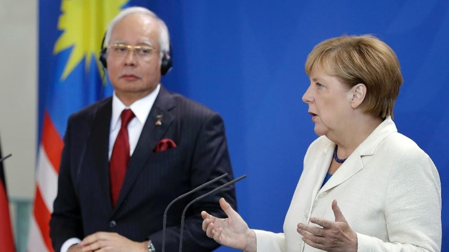 German Chancellor Angela Merkel, right, and Prime Minister of Malaysia Najib Razak, left, address the media during a joint press conference as part of a meeting at the chancellery in Berlin, Germany, Tuesday, Sept. 27, 2016. (AP Photo/Michael Sohn)