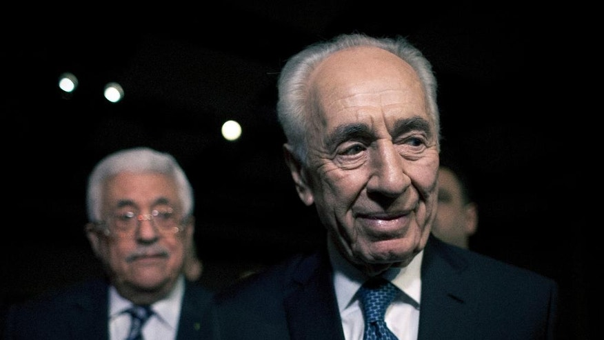 FILE - In this May 22, 2015, file photo, former Israeli President Shimon Peres, right, and Palestinian President Mahmoud Abbas arrive to attend the opening session of the World Economic Forum at the King Hussien convention center, Southern Shuneh, Jordan. Shimon Peres, a former Israeli president and prime minister, whose life story mirrored that of the Jewish state and who was celebrated around the world as a Nobel prize-winning visionary who pushed his country toward peace, has died, the Israeli news website YNet reported early Wednesday, Sept. 28, 2016. He was 93. (AP Photo/Nasser Nasser, File)