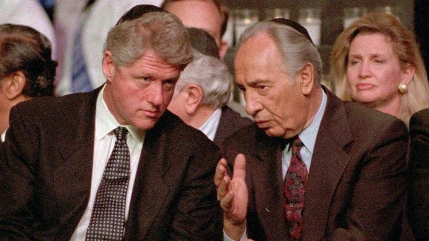 FILE - In this Sunday, April 30, 1995, file photo, President Bill Clinton, left, listens to Israeli Foreign Minister Shimon Peres at the American Gathering of Jewish Holocaust Survivors, at the Paramount Theater in New York's Madison Square Garden. Peres, a former Israeli president and prime minister, whose life story mirrored that of the Jewish state and who was celebrated around the world as a Nobel prize-winning visionary who pushed his country toward peace, has died, the Israeli news website YNet reported early Wednesday, Sept. 28, 2016. He was 93. (AP Photo/Joe Tabacca, File)