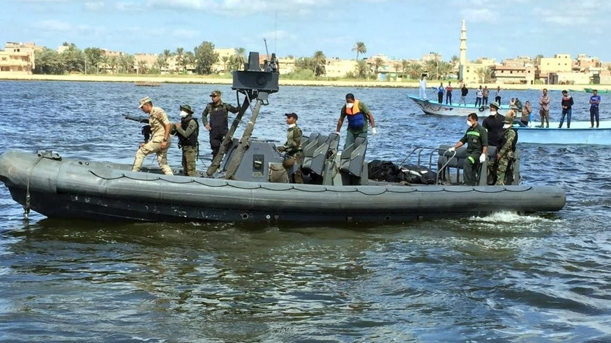 "Egyptian coast guard and rescue workers bring ashore bodies recovered from a Europe-bound boat that capsized off Egypt's Mediterranean coast last week, in Rosetta, Egypt, Tuesday, Sept. 27, 2016 . Dozens of bodies were pulled from the hold of the Mawkib al-Rasoul, or ""Procession of the Prophet,"" the Egyptian fishing boat that sank carrying hundreds of migrants, bringing the toll from the disaster to more than 200 dead. Families of those missing gathered at a pier outside the coastal city of Rosetta as the dead were brought to shore, and relatives went through the grisly task of searching through the body bags for their loved ones. (AP Photo/Maggie Michael)"