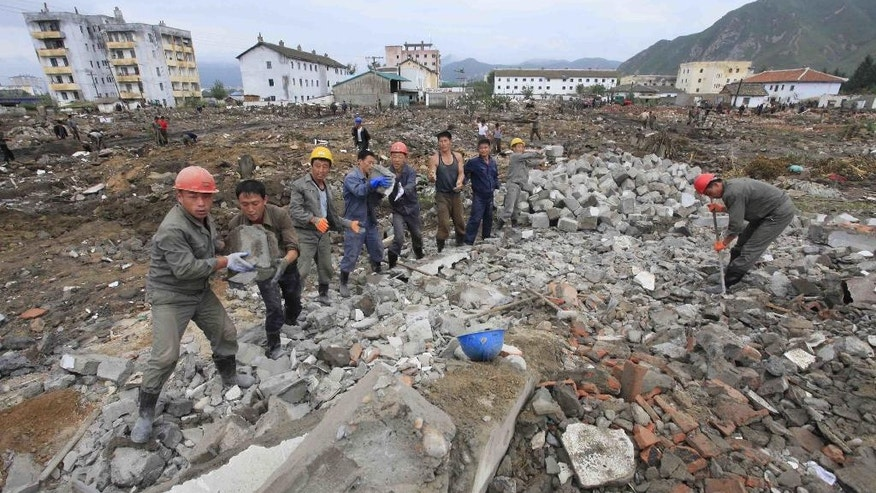 FILE - In this Friday, Sept. 16, 2016, file photo, workers recover cement blocks from flood-damaged areas in Onsong, North Hamgyong Province, North Korea. More than 70,000 people displaced by severe flooding in North Korea nearly a month ago are urgently in need of supplies and shelter before winter sets in, a Red Cross official in Pyongyang said Wednesday. (AP Photo/Kim Kwang Hyon, File)