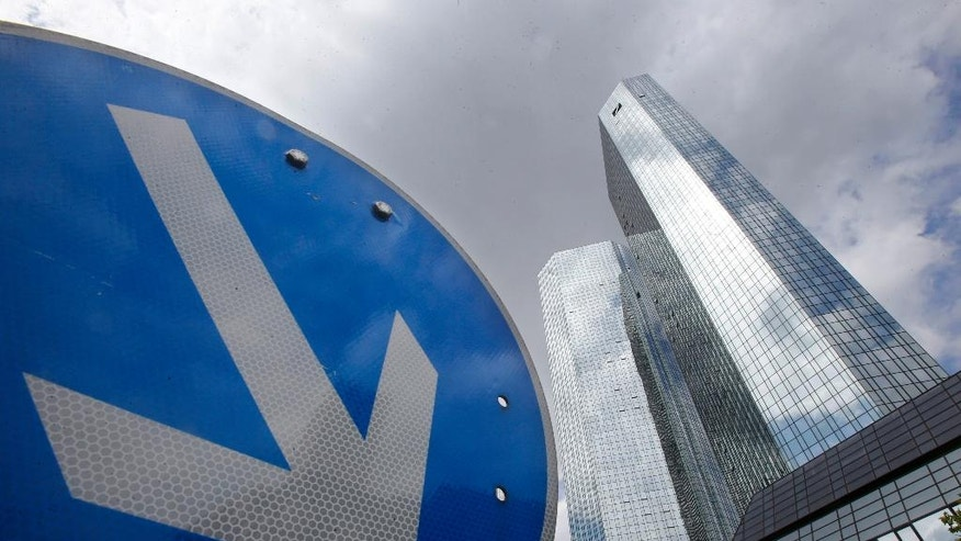 FILE - In this June 9, 2015 file photo the headquarters of Deutsche Bank is photographed in Frankfurt, Germany.   (AP Photo/Michael Probst, file)